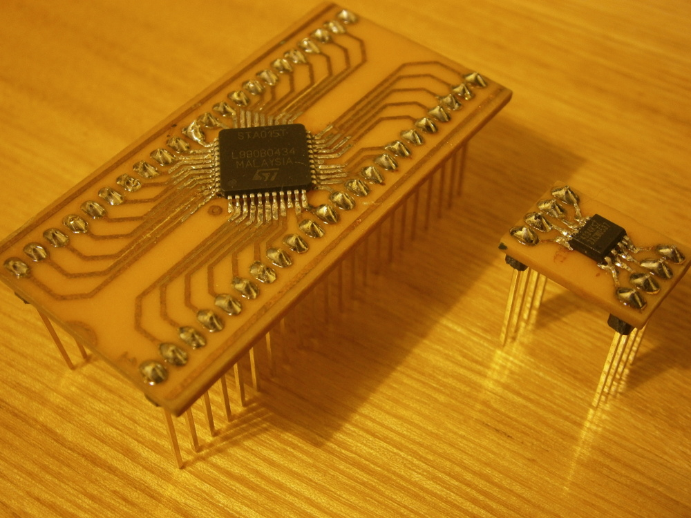 Photo of home made PCBs with QFP and SO-8 chips soldered to them